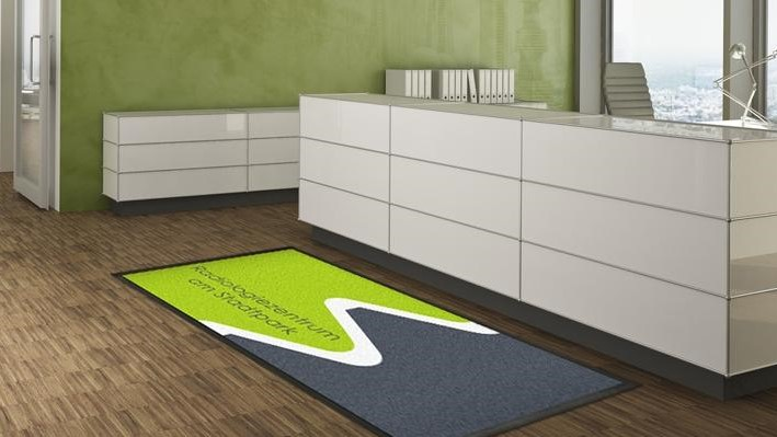 Personalizeable doormat in front of a reception